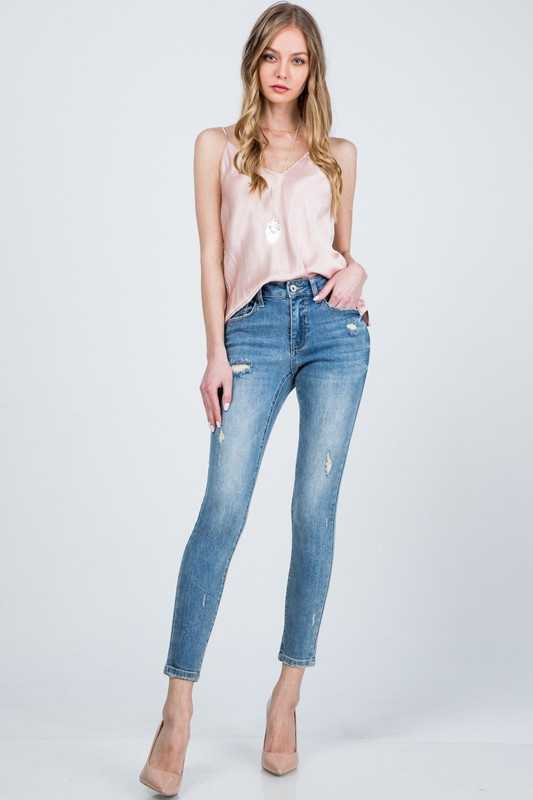 DISTRESSED MID RISE SKINNY WITH CLEAN HEM