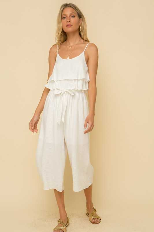 TEXTURED TIERED RUFFLE TIE FRONT JUMPSUIT